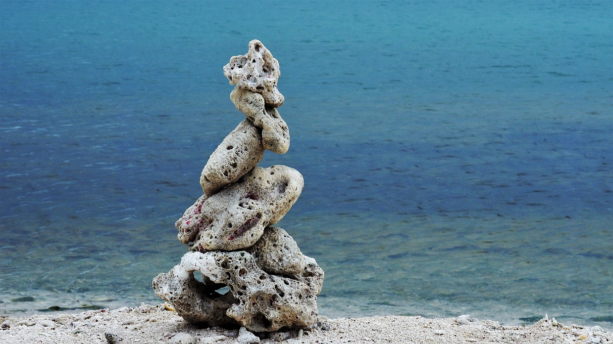 Weathered coral pieces stacked to make a tower.