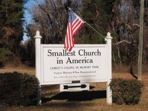 Sign announcing the smallest church in America.