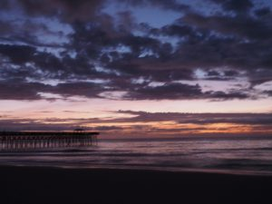 Fuzzy photo of Second Avenue Pier in Myrtle Beach at sunrise.