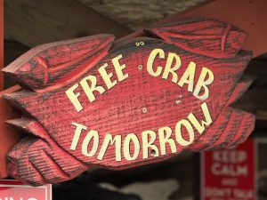 "Sign advertising ""free crab tomorrow"" at Crab Catcher's Restaurant"