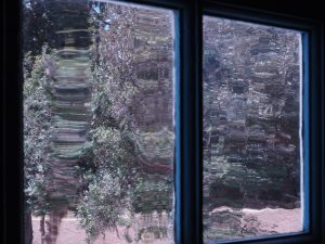 Wavy view through old window pane in Hampton Plantation, Georgetown SC.