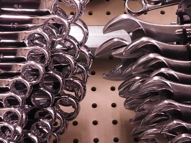Wrenches displayed in hardware store, appearing to attack each other