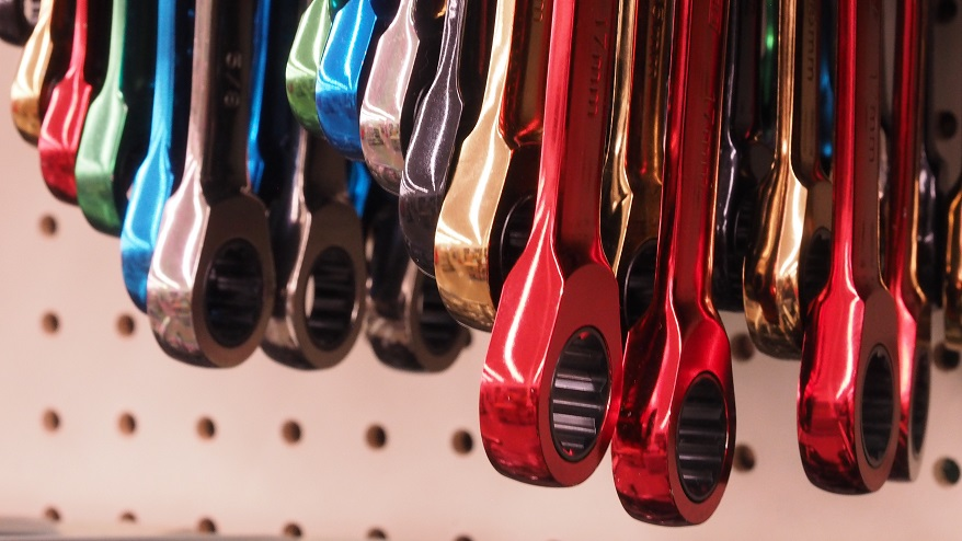 Multicoloured wrench handles in hardware-store display