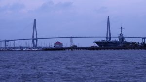 View of both towers of Arthur J. Ravenel Bridge and Yorktown aircraft carrier