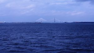 Long-distance view of Arthur J. Ravenel Bridge and Yorktown aircraft carrier