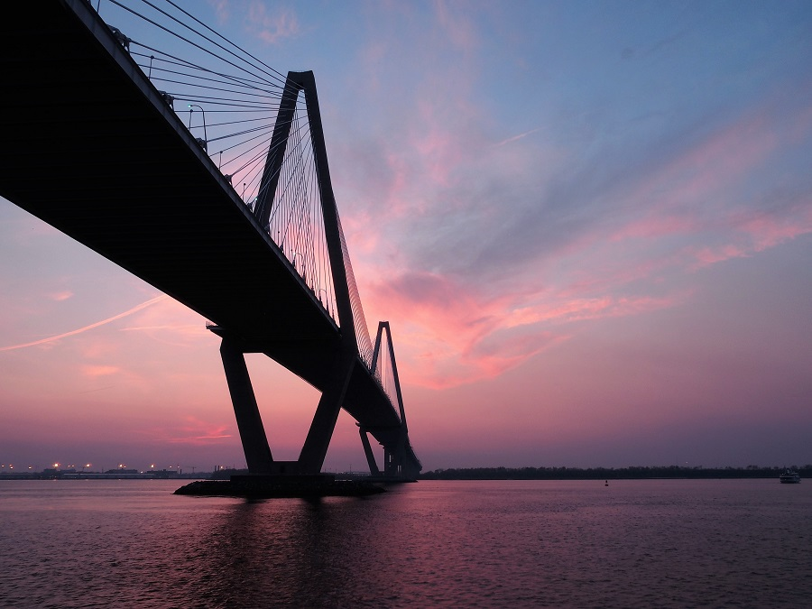 Triangular arches and piers of Bridge over Cooper River, at sunset