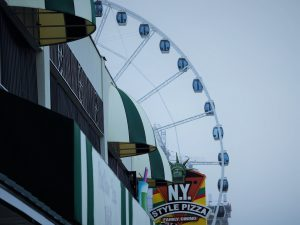 Small arc of Myrtle Beach Skywheel visible past streetfronts