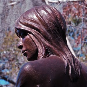 Close-up of head of bronze of girl
