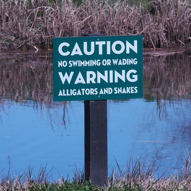 Sign warning of gators and snakes