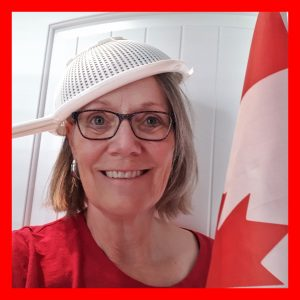 Canada Day celebrator with flag and sieve.