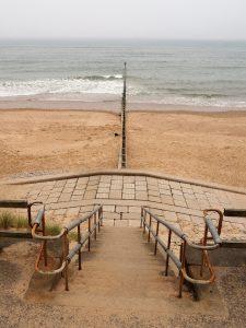 View of wooden breakwater from esplanade walkway