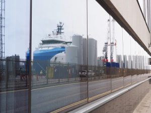 Aberdeen dock infrastructure reflected in office window