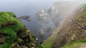 View of rocky cliffs and sea far below