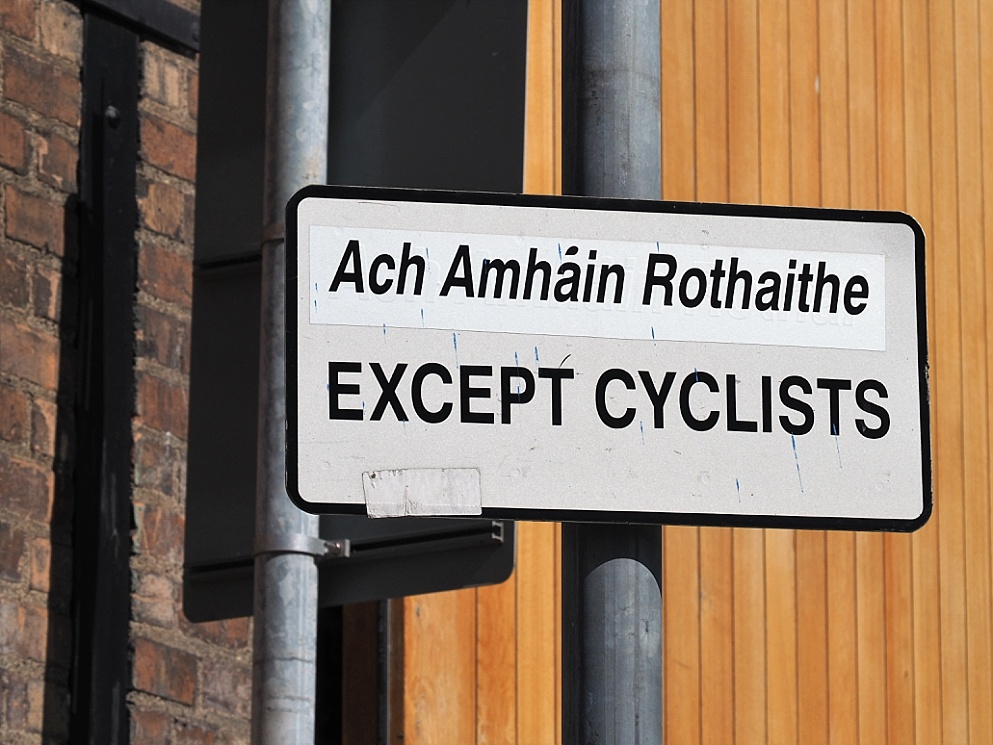 Traffic sign, half Irish, half English