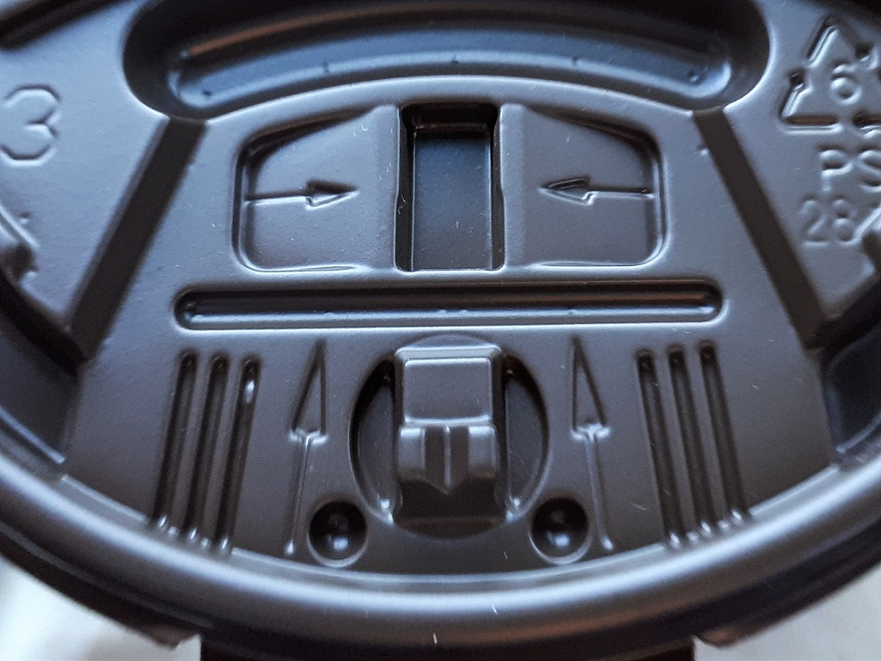 Face on coffee-cup lid