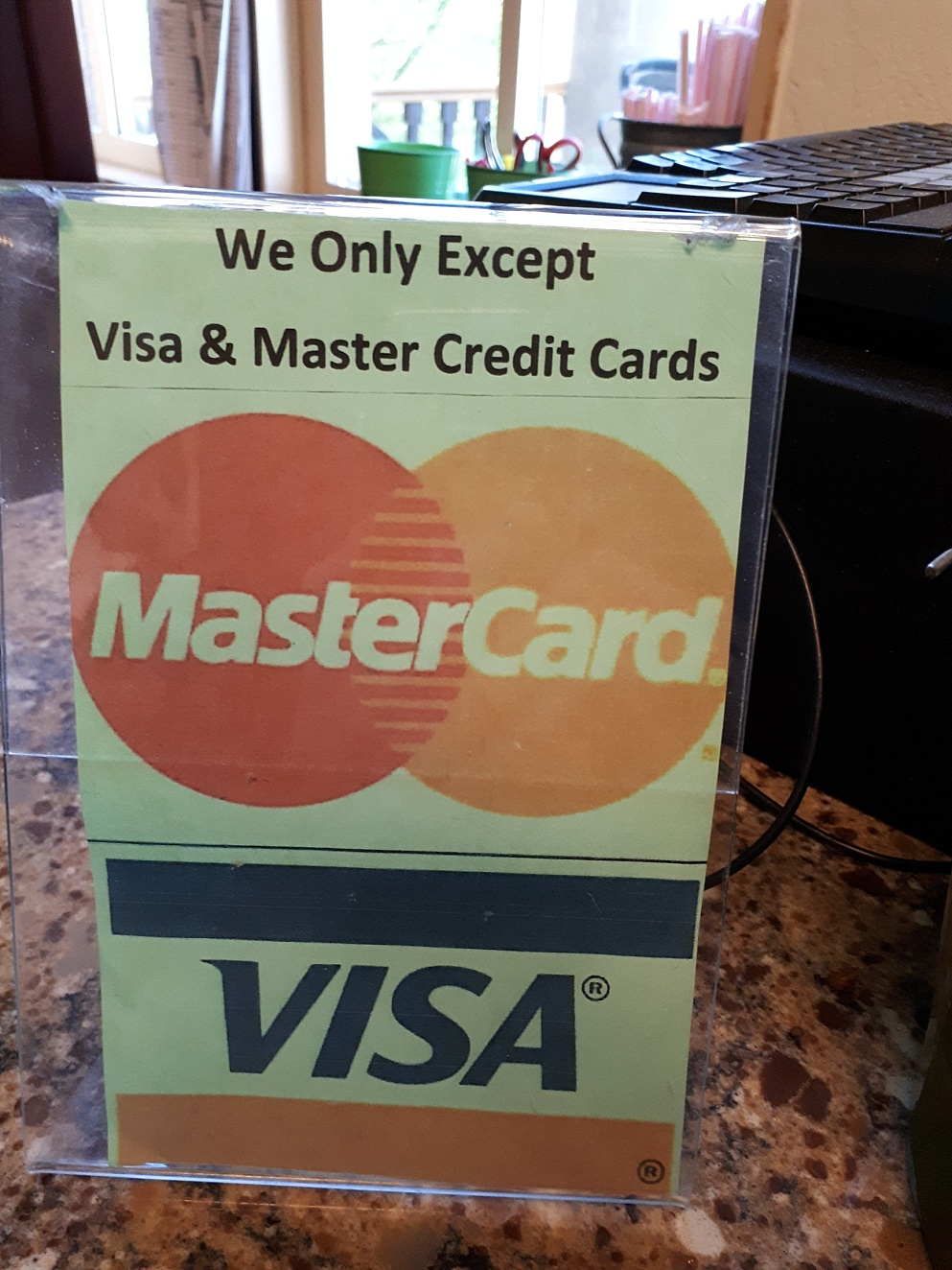 "Sign ""excepting"" - as opposed to ""accepting"" - Visa and MasterCard"