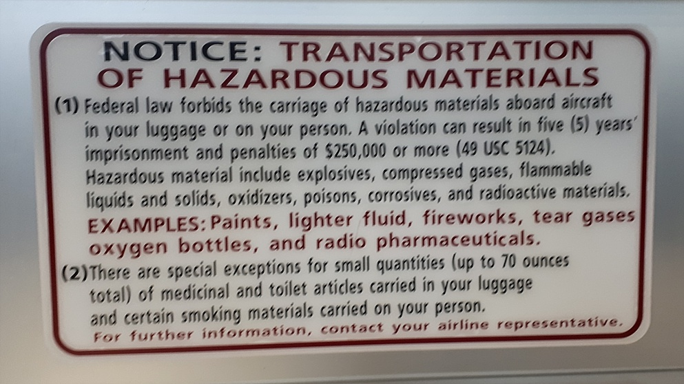 Sign warning about hazardous materials not allowed on airplanes.