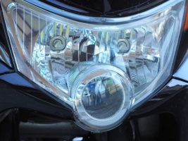 Serendipitous face on motorcycle headlight configuration