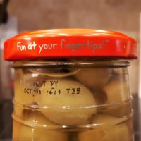Fun is at your fingertips: lid from jar of olive
