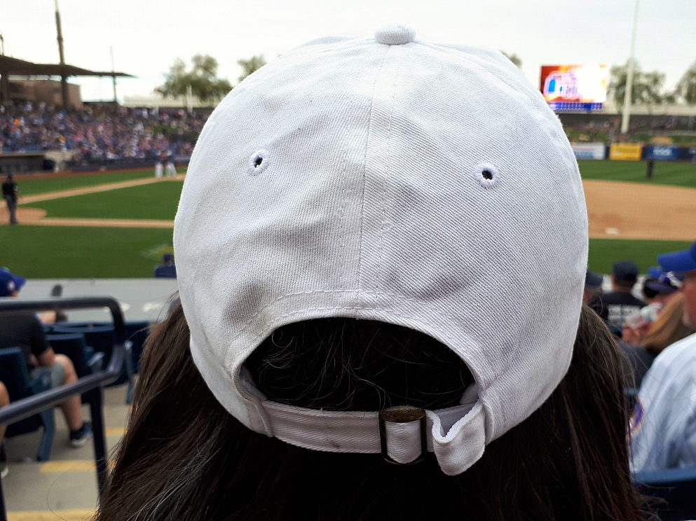 Accidental face on baseball cap.