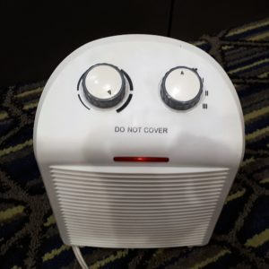 "Accidental face on a space heater,made by two dials and an ""On"" light"