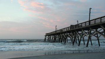 Wooden pier at Surfside Beach at dawn
