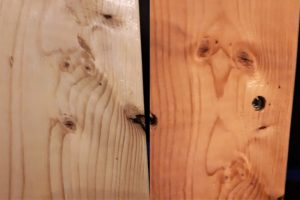 Faces in wood grain of two-by-fours