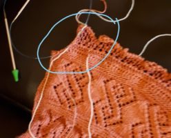 Showing the last bit to be knit on a large shawl.