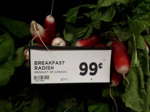 Sign in produce department for breakfast radishes