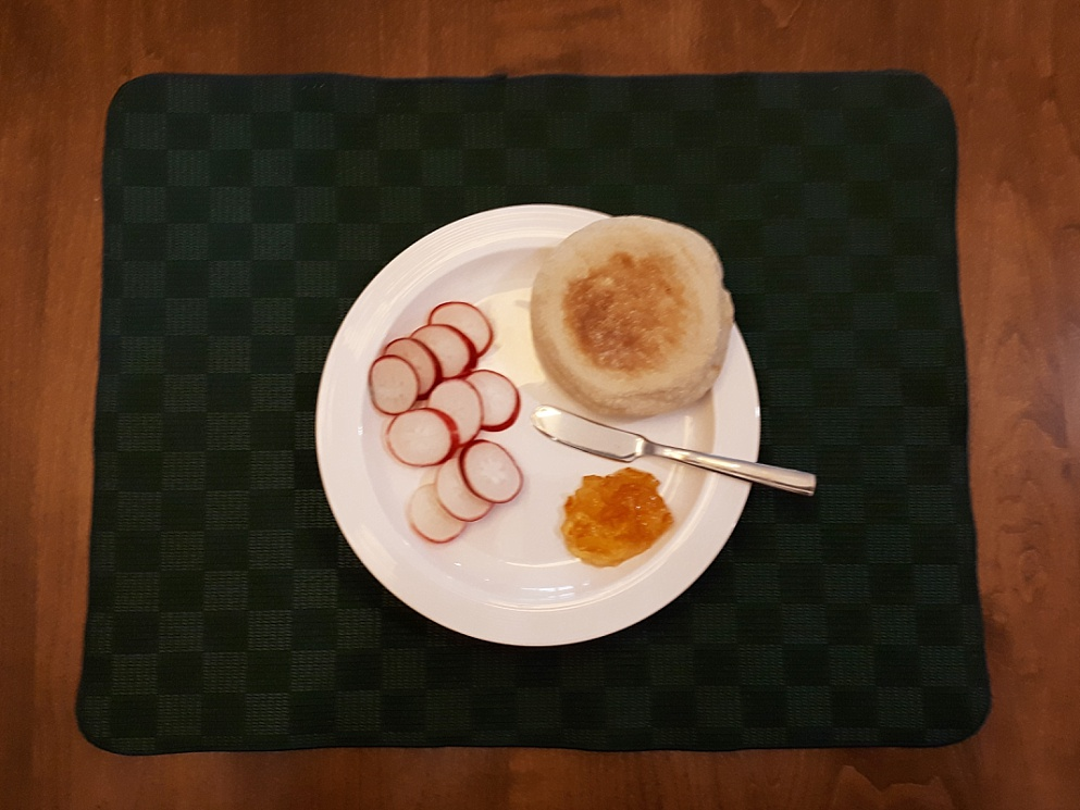 Breakfast radishes served with muffin and marmalade