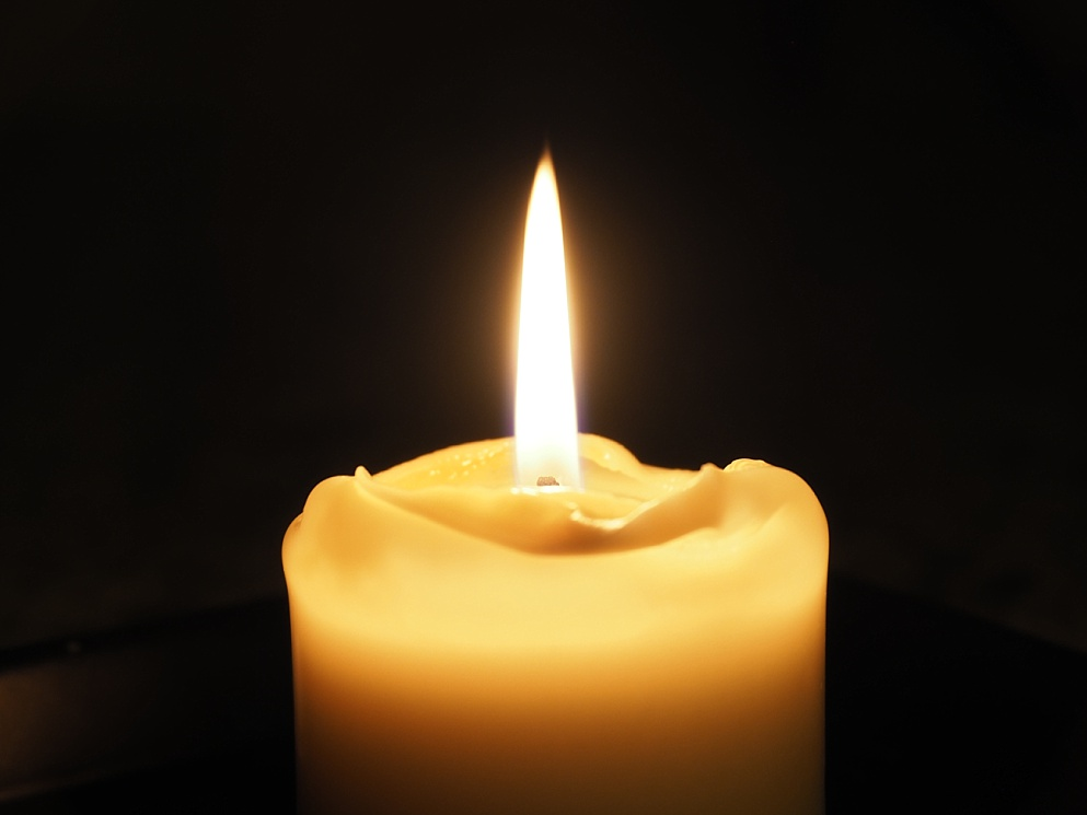 Candle against black background