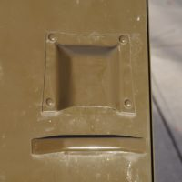 Inadvertent face on garbag-bin latch