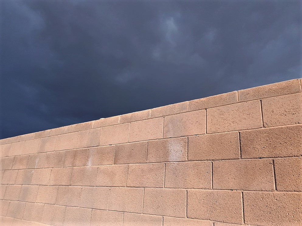 Brick wall and storm clouds