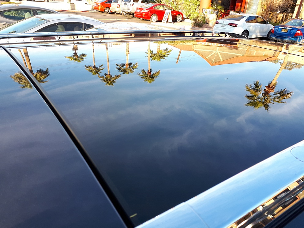 Unmodified photo of reflectionin car hood to show composition problems