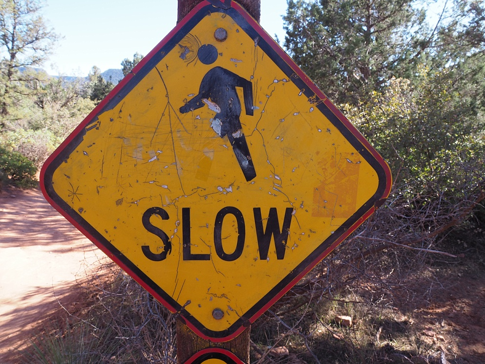 Sign advising of slow walkers