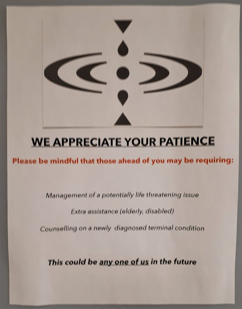Sign urging patience in doctor's office