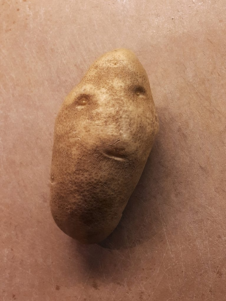 Face on potato